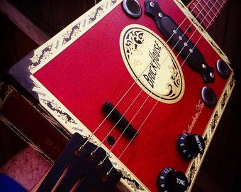 Funguy Mojo Brick House Hot Box Four String Electric Cigar Box Guitar.