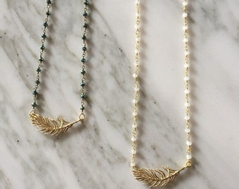 Rosary necklace with feathers.