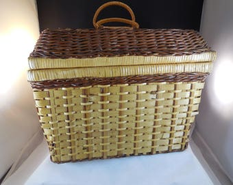 Vintage picnic basket, wicker with plaid cotton lining.