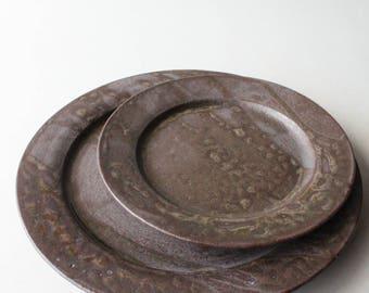set of rusty brown rimmed dessert/dinner plate