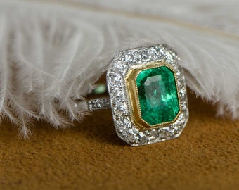 Emerald Platinum and Diamond Halo Ring