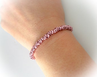 Bracelet with knots in pink aluminum