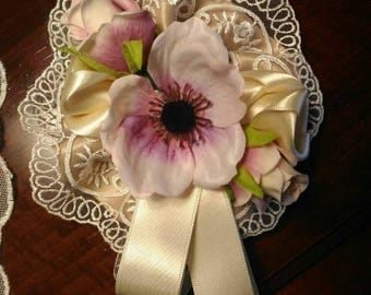 Composition of roses with magnet or pin.