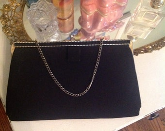 Black Vintage evening bag.....clutch style with gold chain......kiss closure at top
