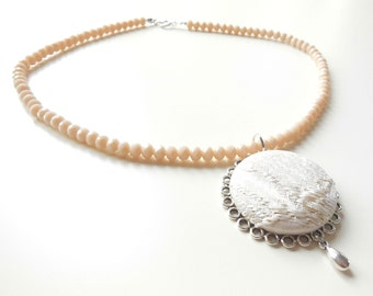 Necklace with filigree pendants, with  fabric botton