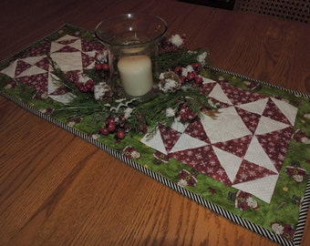 """Christmas Runner with Two Ohio Stars,   Santa Fabric in the Center    32"""" x 14"""""""