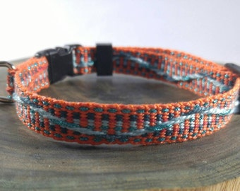 Breakaway Cat Collar - Handwoven; Safety buckle; Adjustable - orange with sparkly blue wave; Optional tag