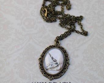 Unicorn's skull cabochon necklace