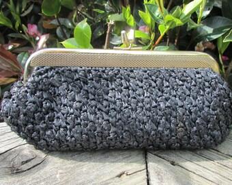 black evening bag vintage black bag black matt weave colour circa, 1970s, compact size, strong texture and robust clasp,vintage elegance.