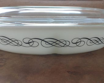 Vintage Black scroll Pyrex divided casserole dish with lid. Milk Glass collectible Pyrex with black.Divided serving dish.