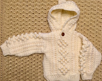 Hand-crocheted, vintage-inspired Aran fisherman cable baby sweater