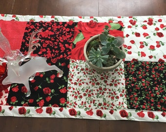 Roses table runner to usher in spring flowers. 50 by 20 inches, reversible.