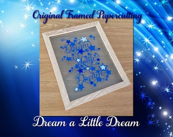 Dream a Little Dream Original Papercutting -handcut paper with glitter accents floated between glass on a wooden effect frame ready to hana