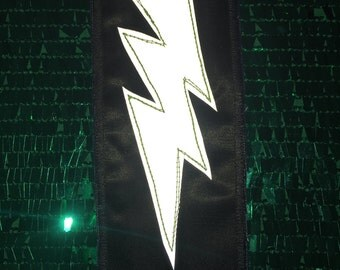 Black Lightening Reflective Patch: promotes visibility in the dark for cyclists, pedestrians, children, bikers, festival goers, etc.!