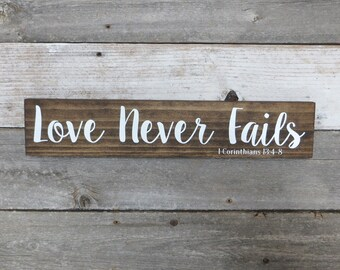 """Rustic Hand Painted """"Love Never Fails"""" Wood Sign - 18""""x3.5"""""""