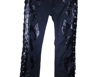 Faux Black Leather Axe shape design  on a pair of Vintage black pants with hand stiched side lace up