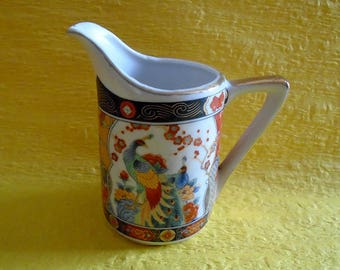 Japanese vintage pottery milk pitcher with design of peacocks and flowers