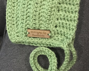 Crocheted pixie baby bonnet