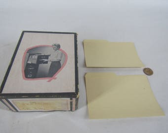 Box of vintage 4 by 6 inch folders with great graphics