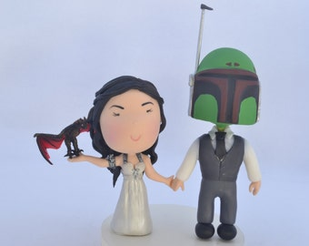 Khaleesi and Bounty Hunter wedding - with pet dragon. Themed cake topper. Wedding figurine.  Handmade. Fully customization.