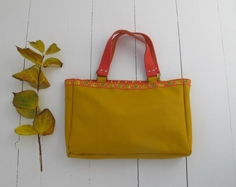 Yellow button calf leather tote with gold.