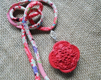 Red cinnabar pendant in silk kimono cord
