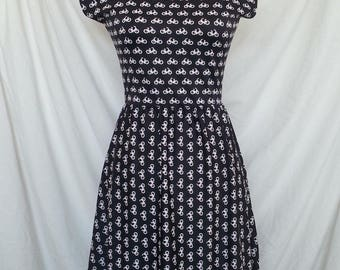 Bettie - Cocktail dress with boat neckline, capped sleeves, knee length skirt, elastic waist and pockets!