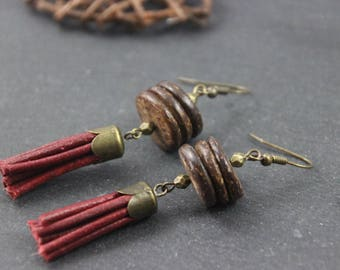 Loops of ethnic nature ears, slices of coconut, Pompom in red leather