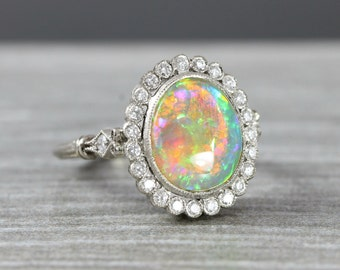 Opal and Diamond halo bezel rubover engagement ring in 18 white carat gold floral flower nature inspired for her handmade ring UK
