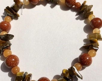 7 inch Tiger's Eye, Goldstone, and Peach Aventurine.