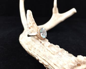 3 Carat Aquamarine and diamond ring set in 14K yellow gold