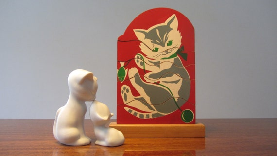 Stacking Toy Puzzles : Vintage stacking wooden puzzle toy with the figure of a cat in