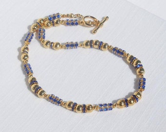 Sapphire blue crystal and gold necklace