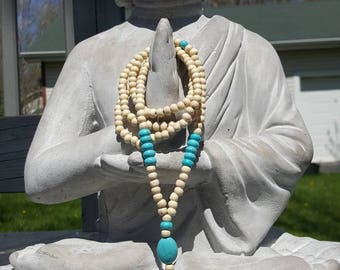 Mala style wooden and turquoise necklace with tassel