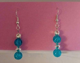 Teal circle bead with silver spacer beads and silver fishhook