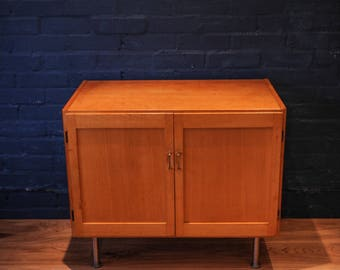 Mid Century Beech twin doored vinyl storage cabinet / cupboard on industrial legs made in West Germany (Shipping is extra)