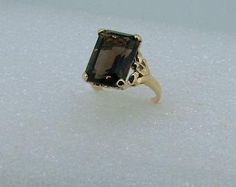 Smoky Quartz and gold ring-smoky quartz ring-Yellow gold 9 carat ring set with an emerald shaped Smoky Quartz