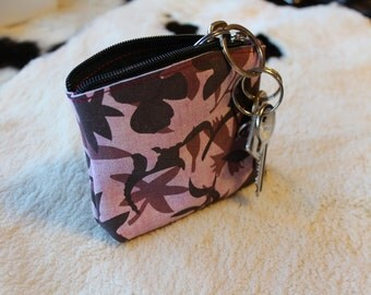 Pink leather change purse with leaves