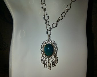 "Cryssicola pendant on sterling large loop 36""  chain."