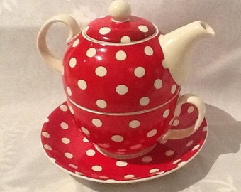 A Red and White Polka Dot Tea Set for One