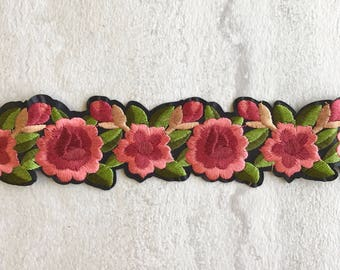Thick pink, green, and black floral choker