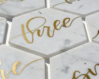 White Marble Hexagon Table Numbers with Handwritten Calligraphy