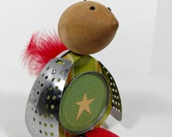Whimsical bird art, junk art, recycled material, bird sculpture, star, feathers, repurposed material, tin, metal,