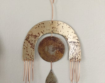 wall hanging / crying moon eye under arc