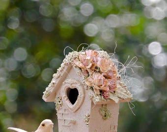 Decorative light green birdhouse