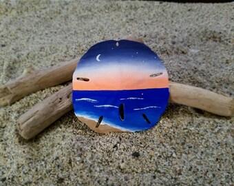 Dusk over ocean sand dollar ornament