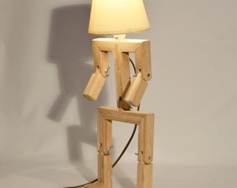 Wooden design lamp in the form of a little personage with movable arms and legs, Hat by Lune et Animo