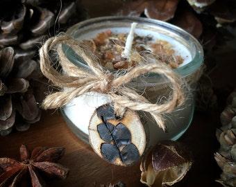 Mandarin and myrrh candle with a wood burned tag