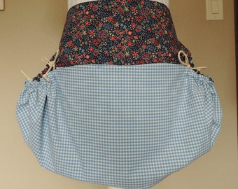 Beautiful floral harvest apron with blue gingham accents and large embroidered pocket