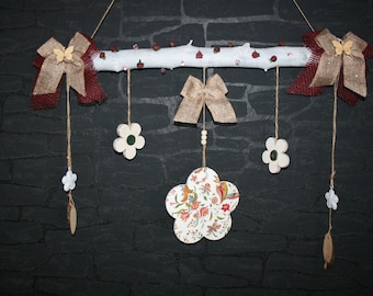 Work with flowers and bows on a branch
